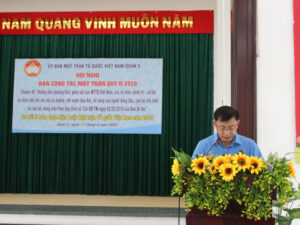 Ông Trần Nam Đức - Phó Chủ tịch Ủy ban MTTQ Quận báo cáo sơ kết 5 năm thực hiện Luật MTTQ